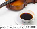 Old violin and cup of coffee on the white table 29149086
