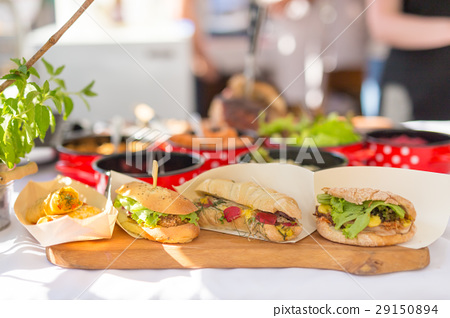 Varieties of home made sandwiches beeing sold on 29150894