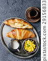 Breakfast with croissant and mango fruit 29156833