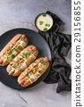 Hot dogs with cheese sauce and mustard 29156855