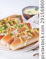 Hot dogs with cheese sauce and mustard 29156860