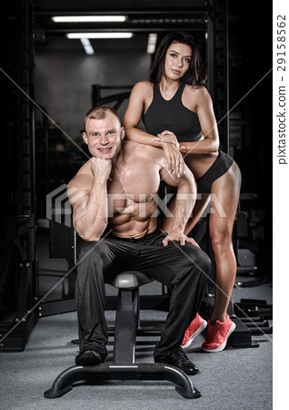 sexy caucasian man and woman in gym . 29158562