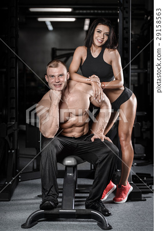 sexy caucasian man and woman in gym . 29158563