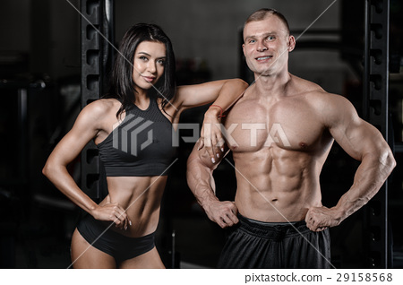 sexy caucasian man and woman in gym . 29158568