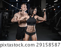 sexy caucasian man and woman in gym . 29158587