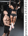 sexy caucasian man and woman in gym . 29158591