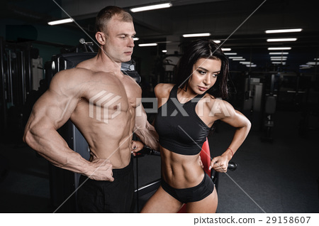 sexy caucasian man and woman in gym . 29158607