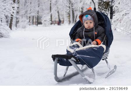 Little boy enjoying a sleigh ride 29159649