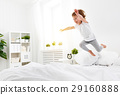 happy child girl  jumps and plays bed 29160888