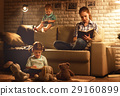 Family before going to bed mother and children read books and pl 29160899
