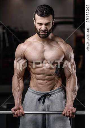 Handsome fitness model train in gym gain muscle 29161292