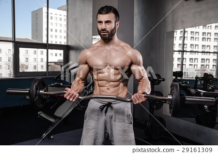 Handsome fitness model train in gym gain muscle 29161309