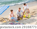Family with four children playing on beach 29168773