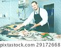 man, fish, squid 29172668