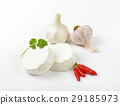 Soft white cheese, red chili peppers and garlic 29185973