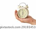 Hand holding retro alarm clock white background 29193453