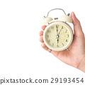 Hand holding retro alarm clock white background 29193454