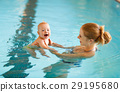 Mother and baby swim  in pool 29195680