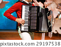 The musician playing the accordion 29197538
