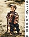 youn boy playing accordion 29201315