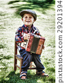 happy young boy playing accordion 29201394