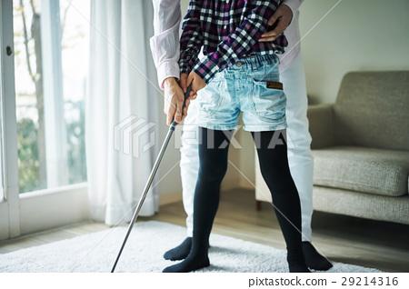 Parents enjoying golf 29214316
