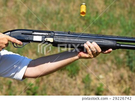 Shooting with a gun 29226742