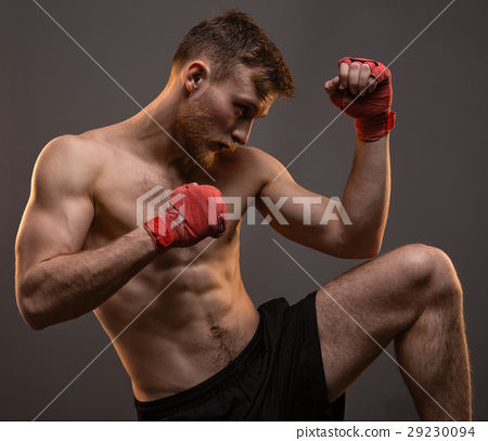 Muscular young boxer with leg up 29230094