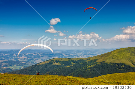 Skydiving extreme over the mountains 29232530