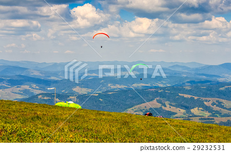 Skydiving extreme over the mountains 29232531