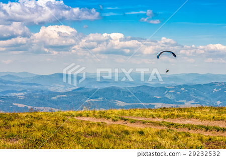 Skydiving extreme over the mountains 29232532