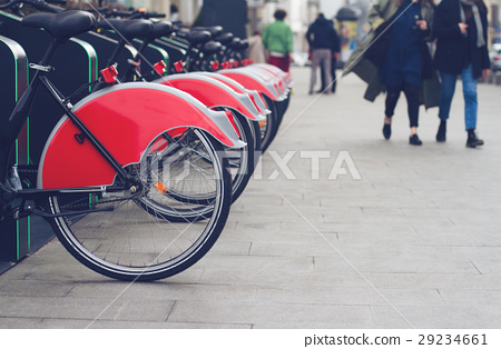 city bike stand with red bicycles 29234661