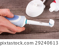 Electric Toothbrush with toothpaste in hand on an 29240613