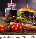 Close-up of home made burgers, wooden desk  29250192