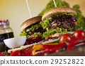 Close-up of home made burgers, wooden desk  29252822