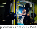 handsome fitness man weightlifting workout in gym 29253544