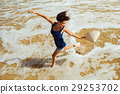 happy girl jumping on the beach top view 29253702