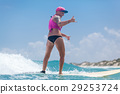 happy woman surfing in waves 29253724