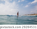 surfing woman with surfing board back view 29264531