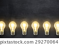 Light bulb lamps on blackboard background  29270064