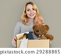 Woman Studio Portriat Casual Carrying a Box Isolated 29288865
