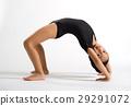 Supple girl bending backwards to form a bridge 29291072