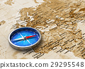 Blue metal compass on the old world map 29295548