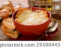 French onion soup with toasts on wooden table. 29300443