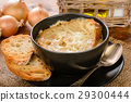 French onion soup with toasts on wooden table. 29300444
