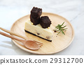 Brownie cheese cake on wood plate 29312700