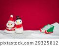 Santa claus, snowman wool doll on snow set up 29325812