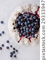 Meringue cake Pavlova with blueberries 29333947