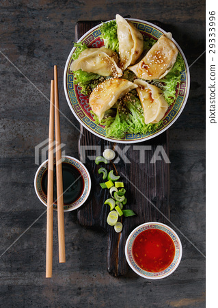 Gyozas potstickers with sauces 29333996