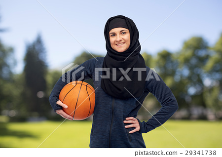 happy muslim woman in hijab with basketball 29341738